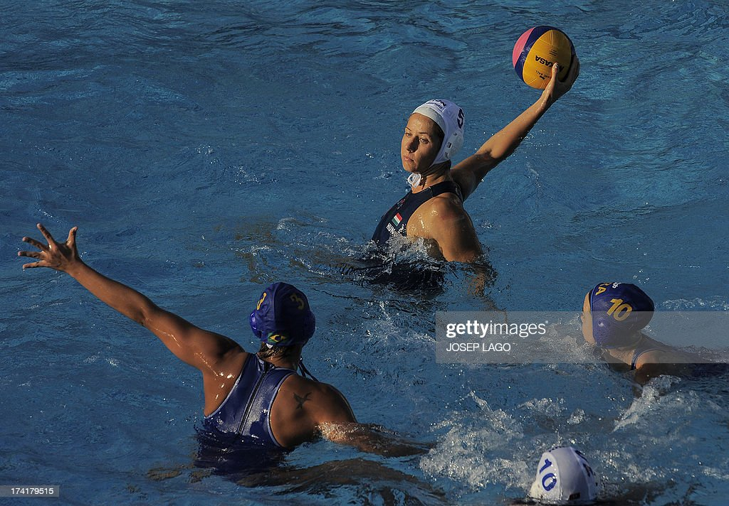 Hungary's Gabriela Szucs (up) fights for the ball with Brazil's Marina Zablith (L) and Brazil's Flavia Vigna (R) during the preliminary rounds of the women's water polo at the FINA World Championships on July 21, 2013 at the Bernat Picornell swimming pool in Barcelona. Hungary won the match 20-6.