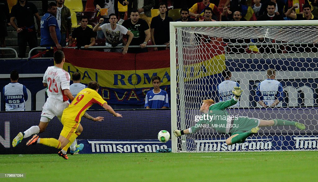 Hungary's goalkeeper Adam Bogdan (R) saves a ball during the FIFA World Cup 2014 group D qualifying football match Romania vs Hungary on September 6, 2013 in Bucharest, Romania.