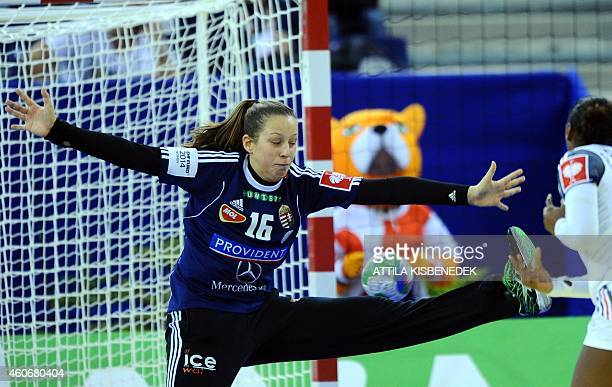 Hungary's goalkeeper Blanka Biro vies with France 's Paule Baudouin in Papp Laszlo Arena of Budapest on December 19 2014 during their 5th place match...