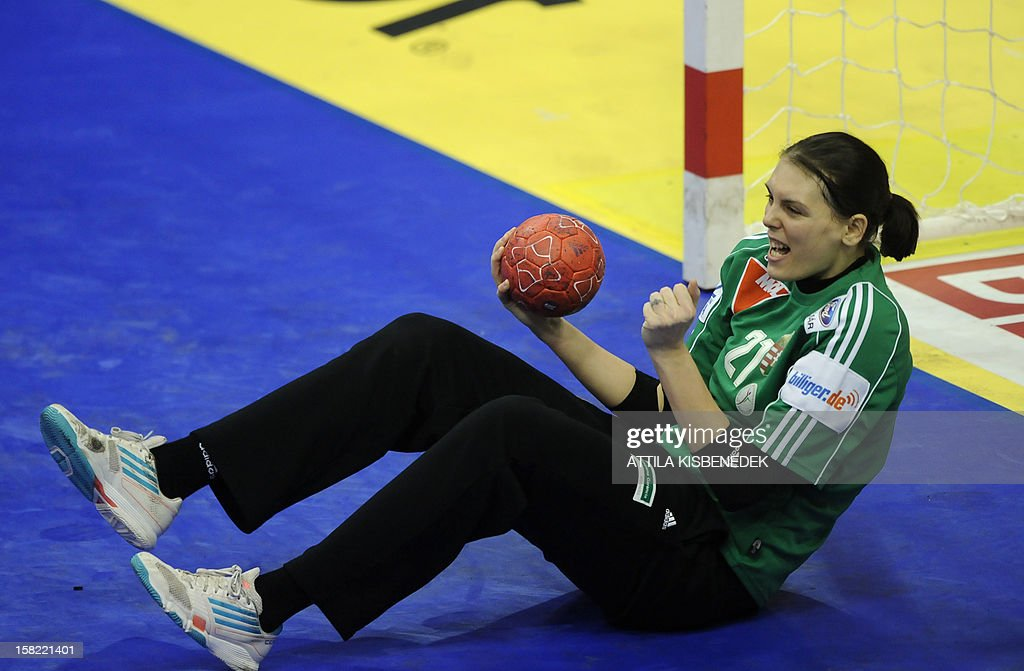 Hungary's goalkeeper Eva Kiss reacts during the 2012 EHF European Women's Handball Championship Group II match of the main round against Romania on December 11 , 2012, at the local arena of Novi Sad town. Hungary won 25-19. AFP PHOTO / ATTILA KISBENEDEK