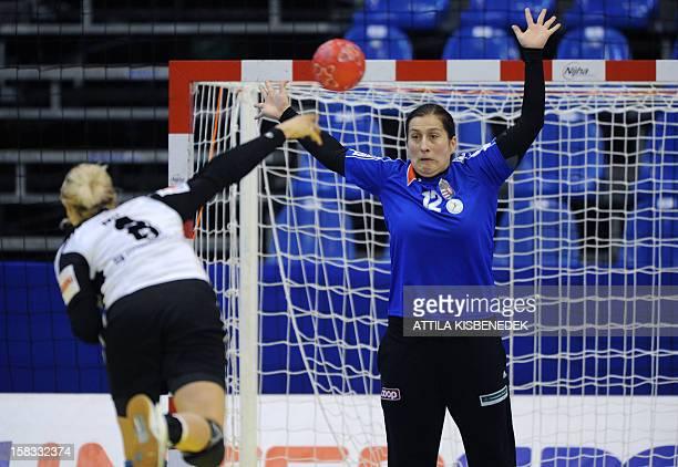Hungary's goalkeeper Orsolya Herr looks at the ball of Russia's leftback Anna Sen during the 2012 EHF European Women's Handball Championship Group II...