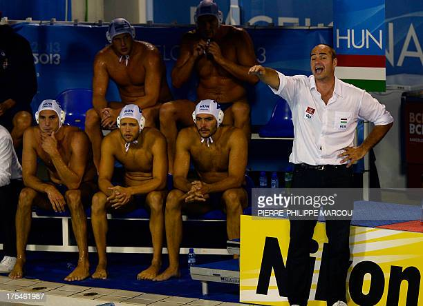 Hungary's head coach Tibor Benedek gives instructions to his players during the men's water polo final match Montenegro vs Hungary at the FINA World...