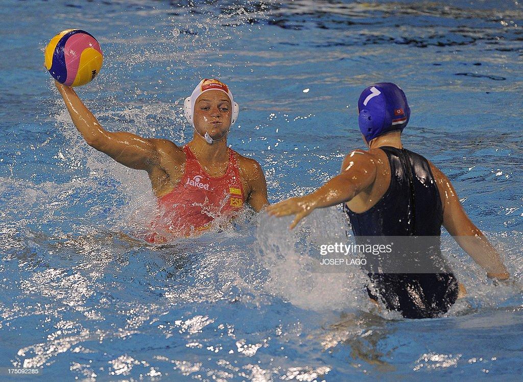 Hungary's Ibolya Kitti Miskolczi vies with Spain's Jennifer Pareja during their women's water polo semifinal match at the FINA World Championships at...