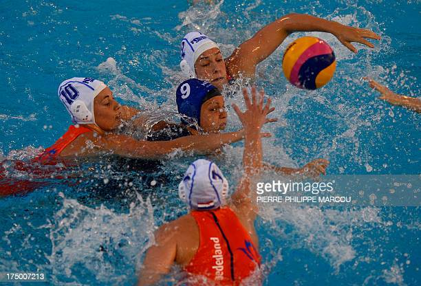 Hungary's Ildiko Toth fights for the ball with the Netherlands' Dagmar Genee Yasemin Smit and Lefke Van Belkum during their women's water polo...