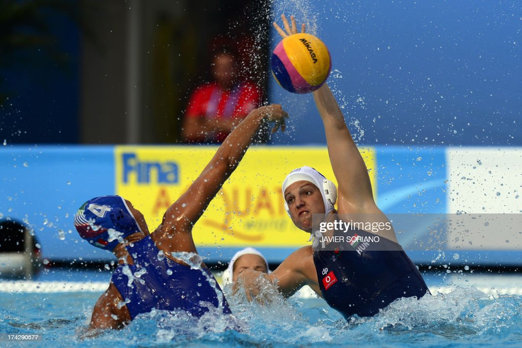 Hungary's Ildiko Toth (R) vies with Italy's Federica Radicchi during their preliminary round match Hungary vs Italy of the women's water polo competition at the FINA World Championships in Bernat Picornell pools in Barcelona on July 23, 2013.