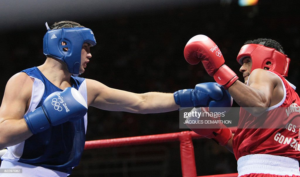 Hungary's Imre Szello fights against Venezuela's Luis Gonzalez during their 2008 Olympic Games Light Heavyweight boxing bout on August 14 2008 in...