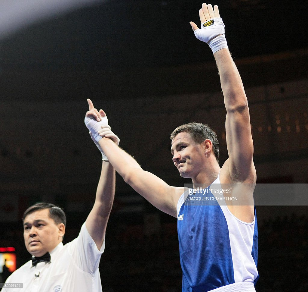 Hungary's Imre Szello is declared winner after defeating Venezuela's Luis Gonzalez during their 2008 Olympic Games Light Heavyweight boxing bout on...