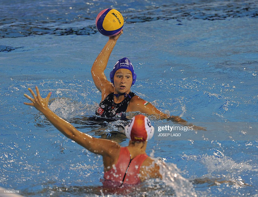 Hungary's Kata Maria Menczinger vies with goalkeeper Spain's Jennifer Pareja during their women's water polo semifinal match at the FINA World...