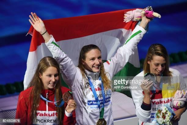 Hungary's Katinka Hosszu Canada's Sydney Pickrem and Spain's Mireia Belmonte celebrate on the podium of the final of the women's 400m individual...