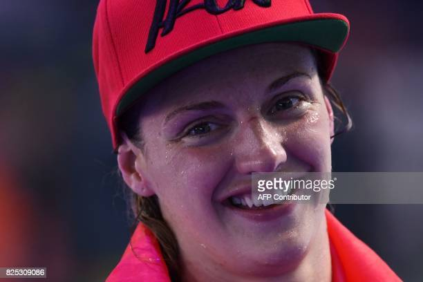 Hungary's Katinka Hosszu celebrates after winning the final of the women's 400m individual medley during the swimming competition at the 2017 FINA...