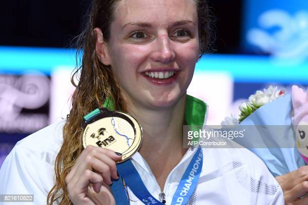Hungary's Katinka Hosszu celebrates on the podium after the women's 200m Individual Medley final during the swimming competition at the 2017 FINA...
