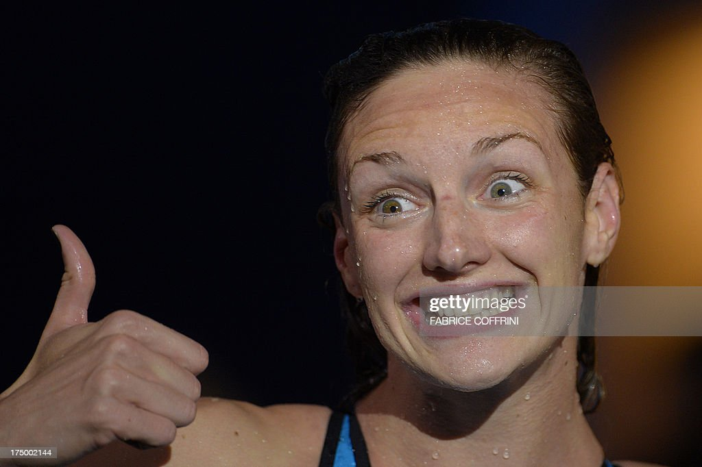 Hungary's Katinka Hosszu gives the thumbs-up after winning the final of the women's 200-metre individual medley swimming event in the FINA World Championships at Palau Sant Jordi in Barcelona on July 29, 2013.