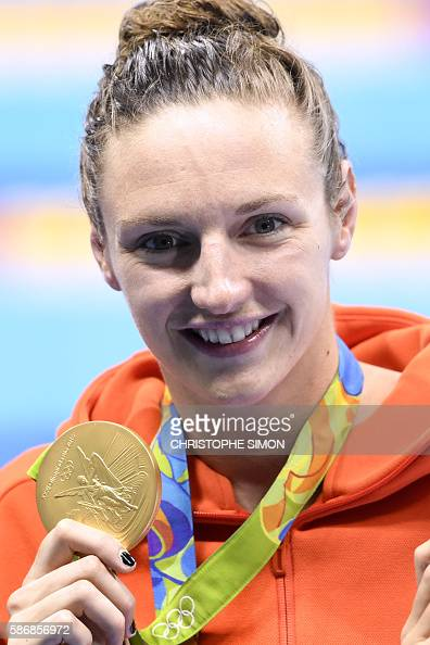 Hungary's Katinka Hosszu poses on the podium with her gold medal after she won the Women's 400m Individual Medley Final during the swimming event at...