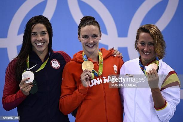 Hungary's Katinka Hosszu poses on the podium with silver medallist USA's Madeline 'Maya' Dirado and bronze medallist Spain's Mireia Belmonte Garcia...