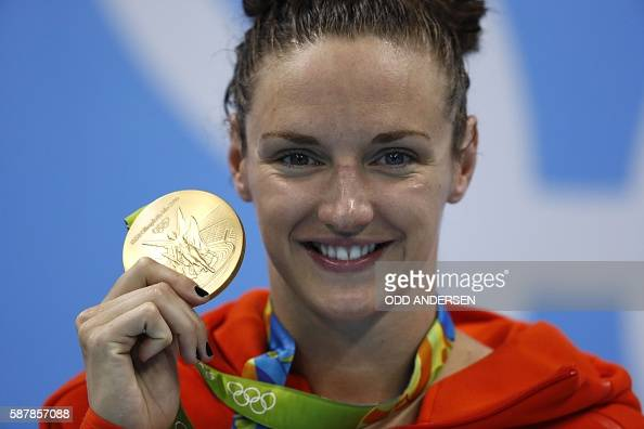 TOPSHOT Hungary's Katinka Hosszu poses with her gold medal on the podium after she won the Women's 200m Individual Medley Final during the swimming...