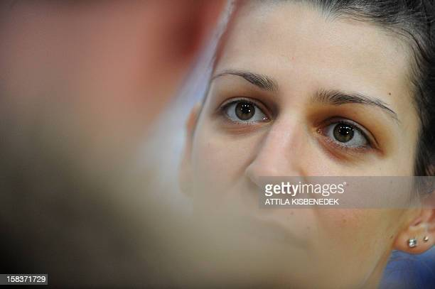 Hungary's Klara Szekeres answers a journalist' questions on the media day of the 2012 EHF European Women's Handball Championship on December 14 2012...