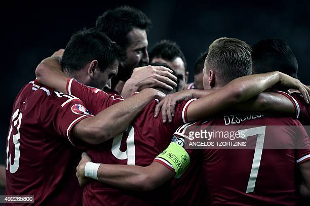 Hungary's Krisztian Nemeth celebrates with teammates after scoring a goal during the UEFA Euro 2016 qualifying Group F football match between Greece...