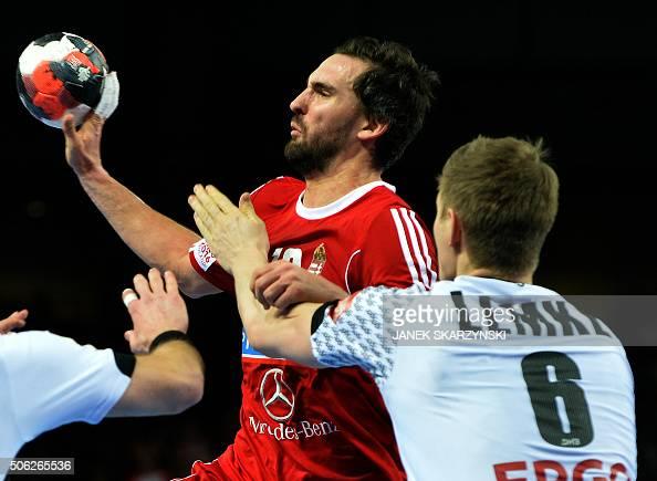 Hungary's Laszlo Nagy challenge Germany's Finn Lemke during the Men's 2016 EHF European Handball Championships between Germany and Hungary in...