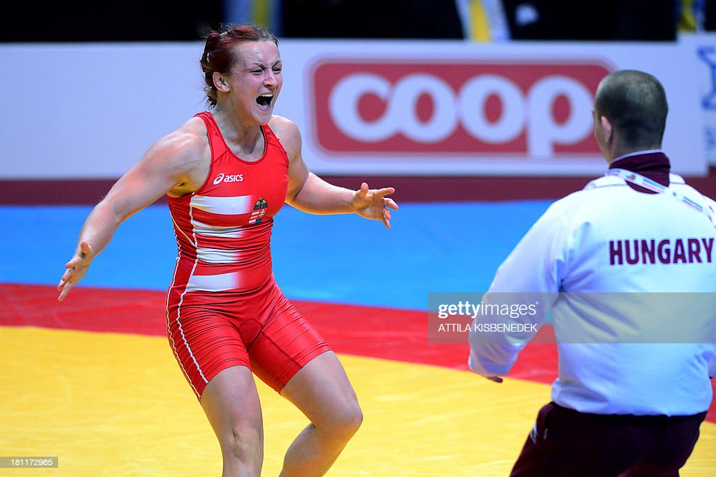 Hungary's Marianna Sastin celebrates her victory over Bulgaria's Taybe Mustafa Yusein (not pictured) during the women's free style 59 kg category final of the FILA World Wrestling Championships in Budapest on September 19, 2013. Sastin won the gold medal. AFP PHOTO / ATTILA KISBENEDEK