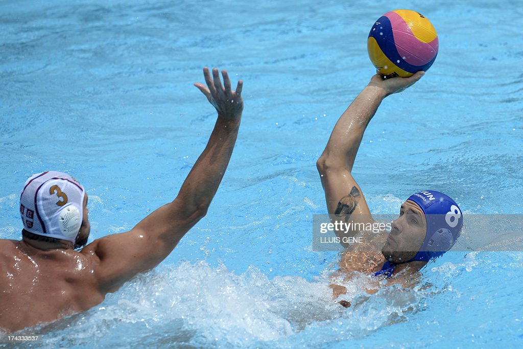 Hungary's Marton Szivos (R) vies with Serbia's Zivko Gocig (L) during the preliminary round match of the men's water polo competition between Serbia and Hungary at the FINA World Championships at the Bernat Picornell swimming pool in Barcelona on July 24, 2013.