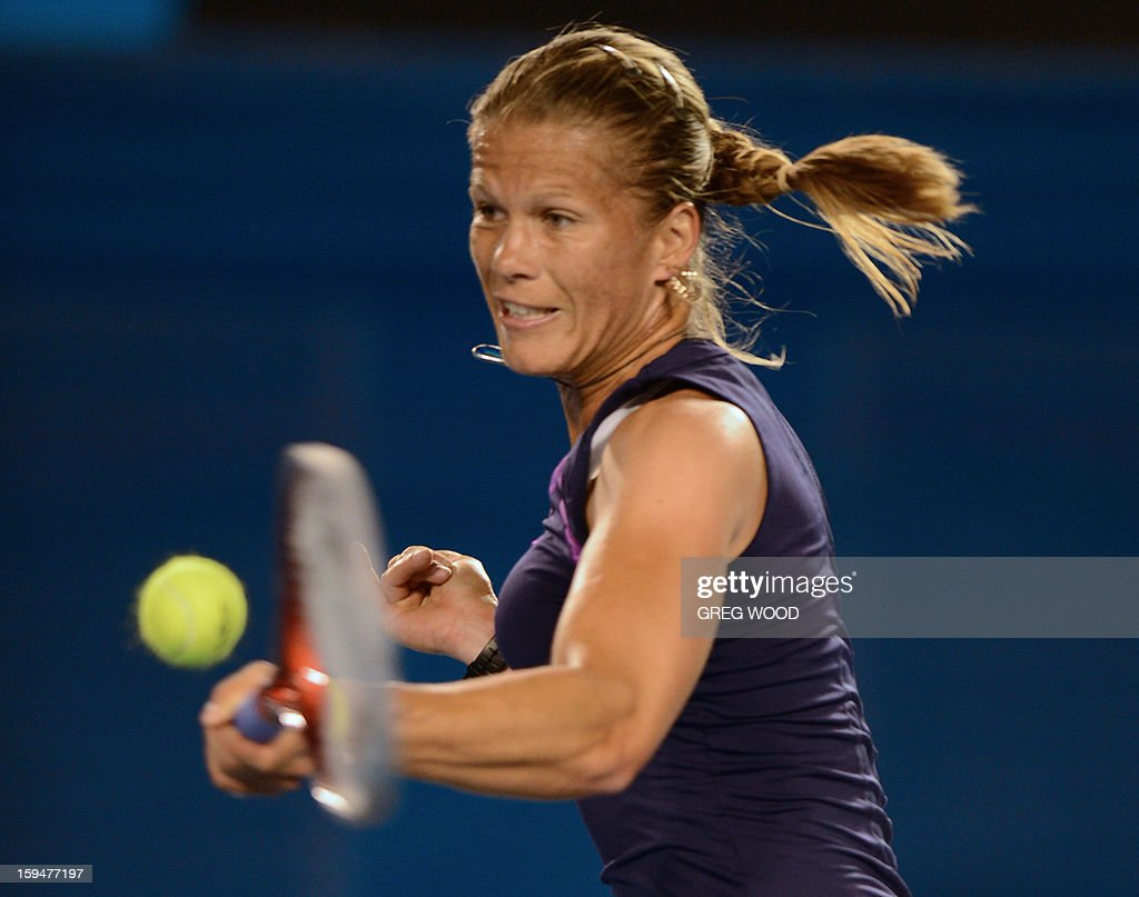 Hungary's Melinda Czink plays a return during her women's singles match against Serbia's Ana Ivanovic on the first day of the Australian Open tennis tournament in Melbourne on January 14, 2013. AFP PHOTO/GREG WOOD IMAGE STRICTLY RESTRICTED TO EDITORIAL USE - STRICTLY NO COMMERCIAL USE