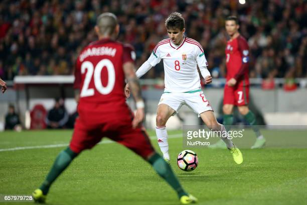 Hungary's midfielder Adam Nagy vies with Portugal's forward Ricardo Quaresma during the FIFA World Cup Russia 2018 qualifier match Portugal vs...