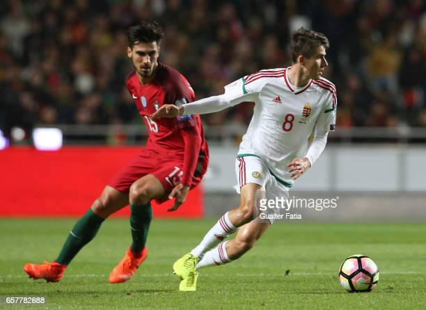 Hungary's midfielder Adam Nagy with Portugal's midfielder Andre Gomes in action during the FIFA 2018 World Cup Qualifier match between Portugal and...