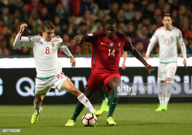 HungaryÕs midfielder Adam Nagy with Portugal's midfielder William Carvalho in action during the FIFA 2018 World Cup Qualifier match between Portugal...