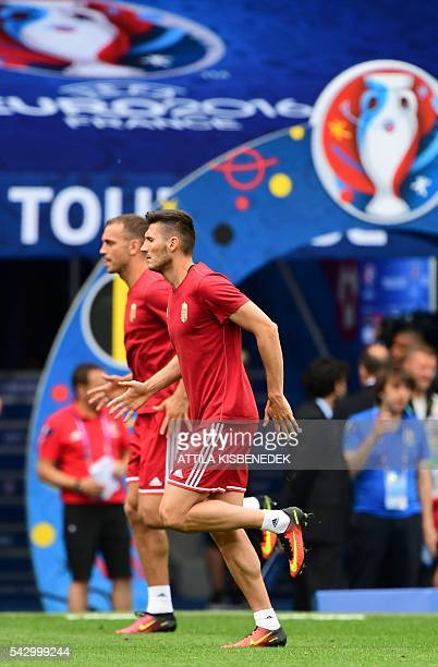 Hungary's midfielder Adam Pinter and defender Roland Juhasz attend a training session at the Stadium Municipal in Toulouse southern France on June 25...