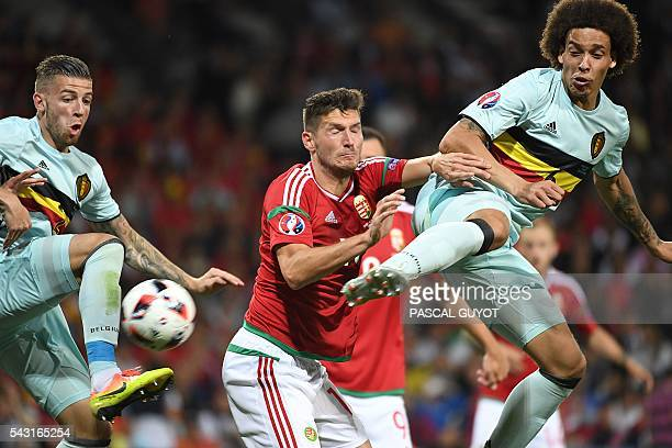 Hungary's midfielder Adam Pinter vies for the ball with Belgium's midfielder Axel Witsel and Belgium's defender Toby Alderweireld during the Euro...