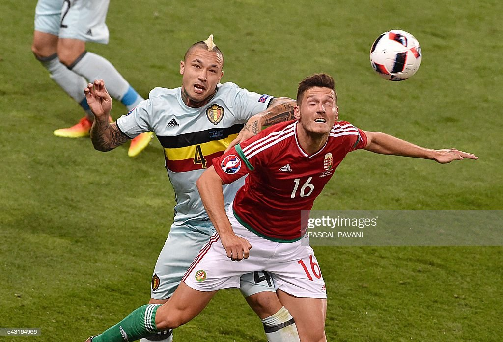 Hungary's midfielder Adam Pinter (R) vies for the header with Belgium's midfielder Radja Nainggolan during the Euro 2016 round of 16 football match between Hungary and Belgium at the Stadium Municipal in Toulouse on June 26, 2016. / AFP / Pascal PAVANI