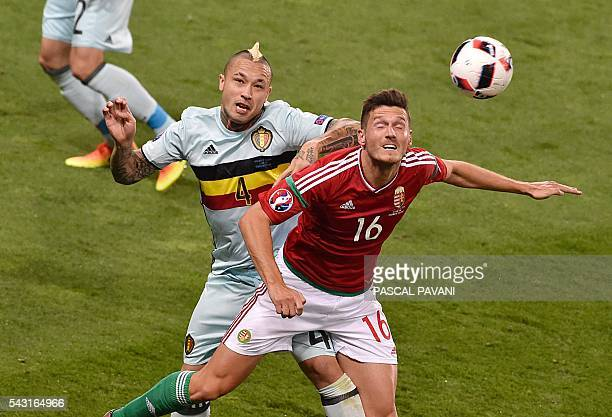 Hungary's midfielder Adam Pinter vies for the header with Belgium's midfielder Radja Nainggolan during the Euro 2016 round of 16 football match...
