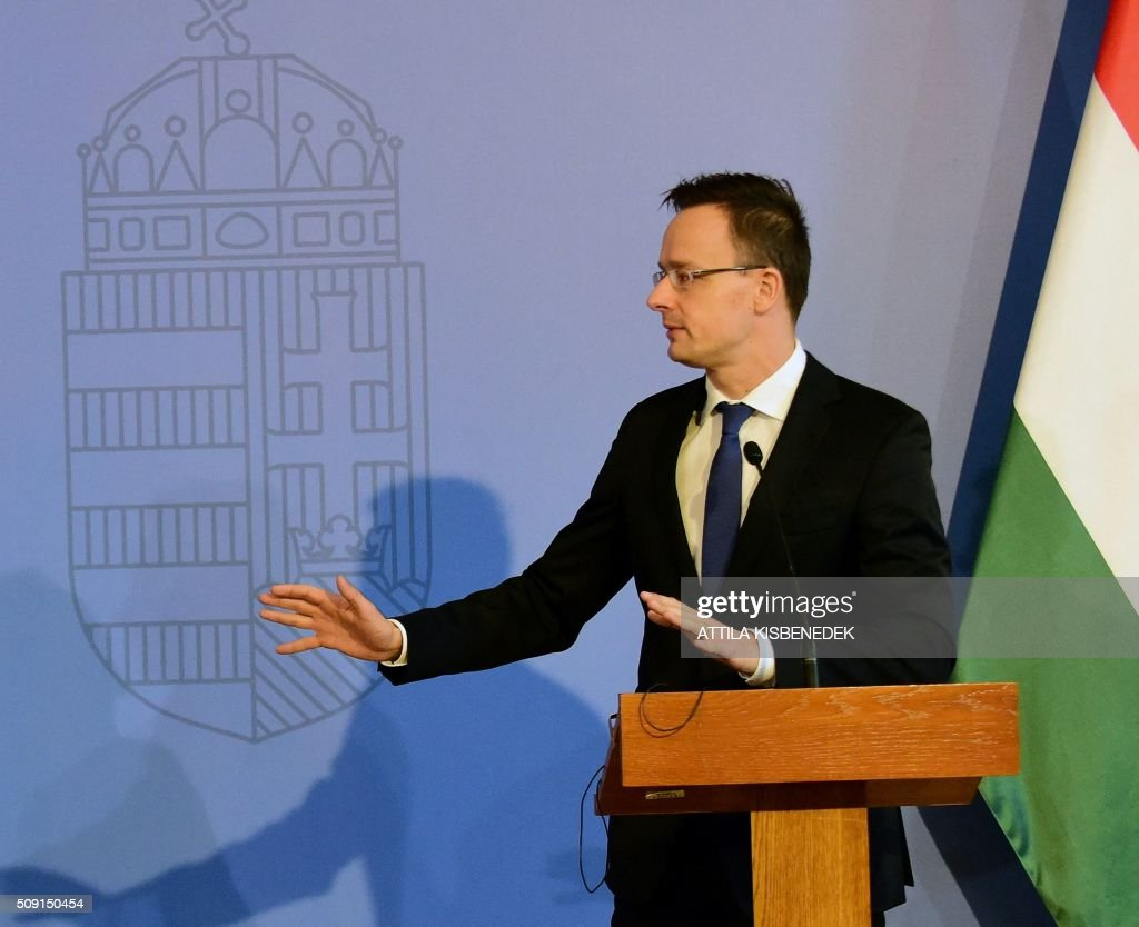 Hungary's Minister of External Economy and Foreign Affairs, Peter Szijjarto, gestures during a joint press conference with Turkish Foreign Minister Mevlut Cavusoglu (unseen), at the Conference Hall of the ministry building in Budapest, on February 9, 2016. / AFP / ATTILA KISBENEDEK