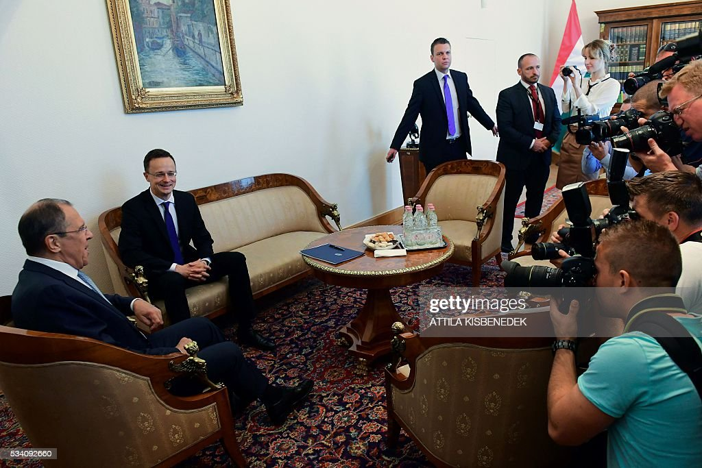 Hungary's Minister of External Economy and Foreign Affairs Peter Szijjarto (2nd L) and Russian Foreign Minister Sergei Lavrov (L) have taken seat for an official meeting at the ministry in Budapest on May 25, 2016. / AFP / ATTILA