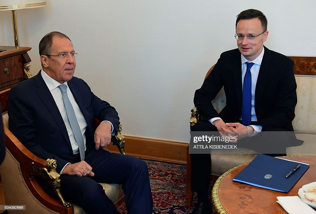 Hungary's Minister of External Economy and Foreign Affairs Peter Szijjarto (R) and Russian Foreign Minister Sergei Lavrov have taken seat for an official meeting at the ministry in Budapest on May 25, 2016. / AFP / ATTILA