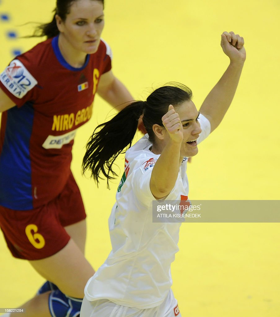 Hungary's Orsolya Verten (R) celebrates scoring next to Romania's Crina Pintea (L) during the 2012 EHF European Women's Handball Championship Group II match of the main round on December 11 , 2012, at the local arena of Novi Sad town. Hungary won 25-19.