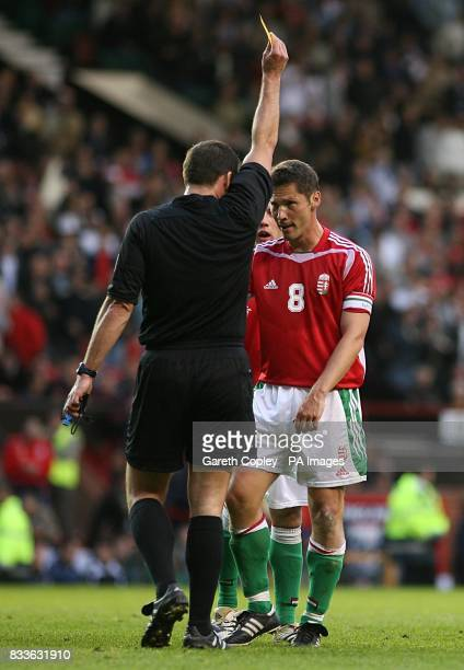 Hungary's Pal Dardai is booked for dissent following the penalty decision