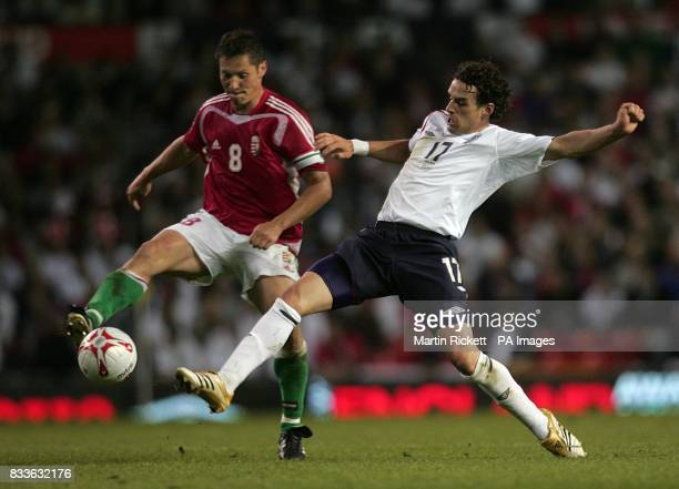 Hungary's Pal Dardai is challenged by England's Owen Hargreaves