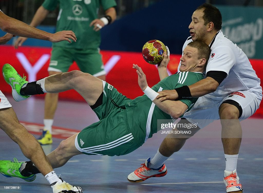 Hungary's pivot Szabolcs Zubai (L) vies with Hungary's left wing Gergo Ivancsik during the 23rd Men's Handball World Championships preliminary round Group D match Hungary vs Algeria at the Caja Magica in Madrid on January 19, 2013. Hungary won 29-25.