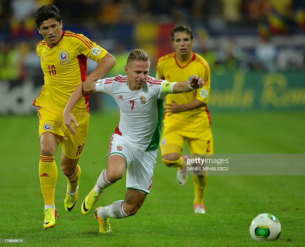 Hungary's player Balazs Dzsudzsak (C) vies for the ball with Romania's Cristian Tanase (L) and Romania's Alexandru Matel during the FIFA World Cup 2014 group D qualifying football match of Romania vs Hungary on September 6, 2013 in Bucharest, Romania. Romania won the match 3-0.