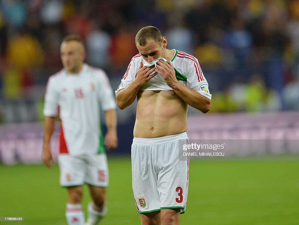 Hungary's player Vilmos Vanczak reacts after the FIFA World Cup 2014 group D qualifying football match Romania vs Hungary on September 6, 2013 in Bucharest, Romania. Romania won 3-0.