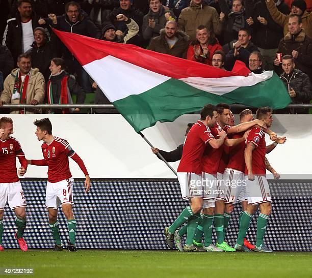 Hungary's players celebrate their score againts Norway during the Euro 2016 playoff football match between Norway and Hungary at the Grupama Arena in...