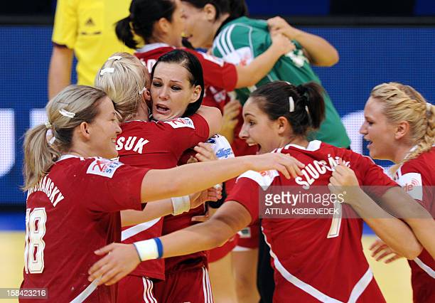 Hungary's players celebrate their victory over Serbia after the 2012 EHF European Women's Handball Championship small final match on December 16 at...
