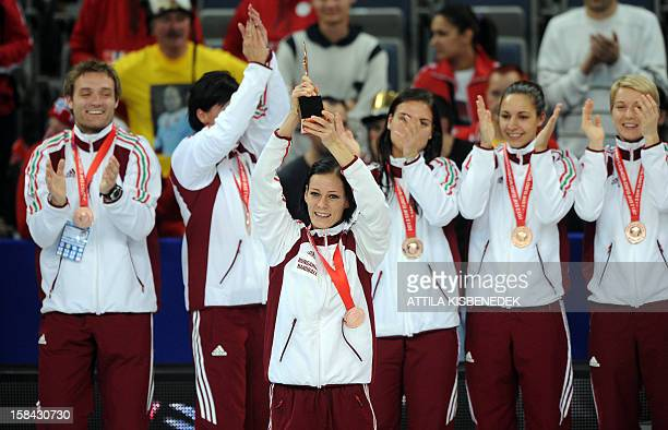 Hungary's players celebrate with their bronze trophy at the end of the 2012 EHF European Women's Handball Championship on December 16 at the KOMBANK...