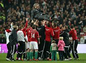 Hungary's players celebrate with their coach Bernd Storck after they win during the Euro 2016 playoff football match between Norway and Hungary at...