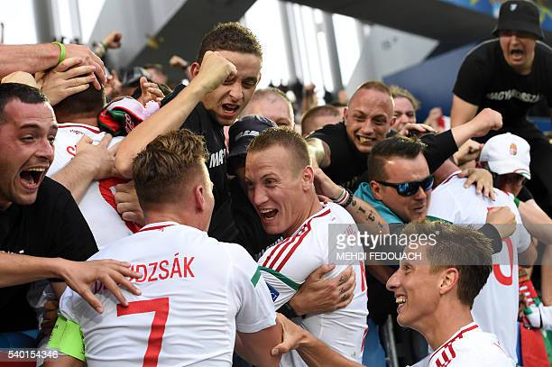 Hungary's players celebrate with their fans after a goal by Hungary's forward Adam Szalai during the Euro 2016 group F football match between Hungary...