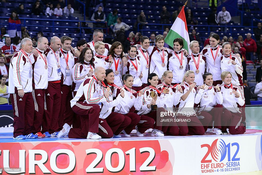 Hungary's players pose on podium after taking the third place during their Women's EHF Euro 2012 Handball Championship final match on December 16, 2012, at the Kombank Arena in Belgrade.