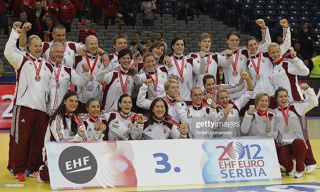 Hungary's players pose on podium after taking the third place during the Women's European Handball Championship 2012 medal ceremony at Arena Hall on December 16, 2012 in Belgrade, Serbia.