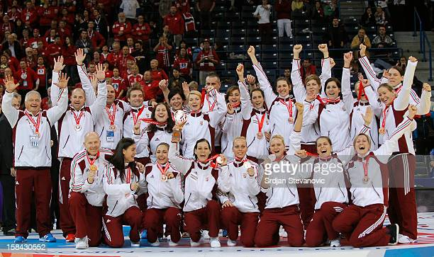 Hungary's players pose on podium after taking the third place during the Women's European Handball Championship 2012 medal ceremony at Arena Hall on...