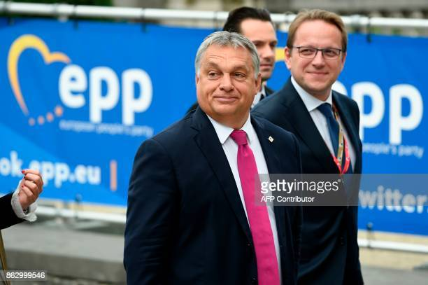 Hungary's Prime minister Viktor Orban arrives at a meeting of the European Peoples Party in Brussels on October 19 2017 on the side of the first day...